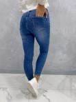 Spodnie jeansowe zapinane na guziki z przetarciami Vilsa 09 - photo #4